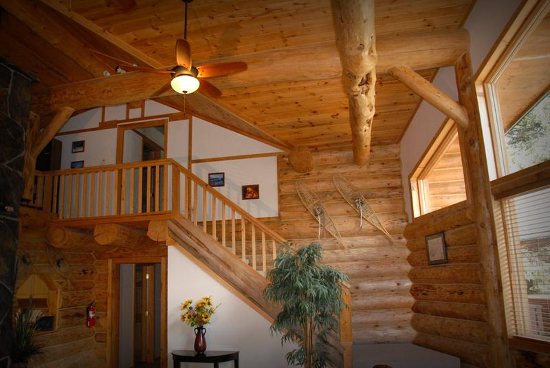 The main floor bedrooms are down the lower hallway, and the master bedroom is in the loft.